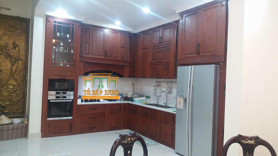 Tủ bếp chữ L gỗ tự nhiên đẹp – Làm tủ bếp HCM